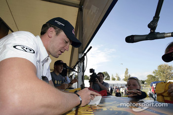 Autograph session for Robert Doornbos and Christian Klien