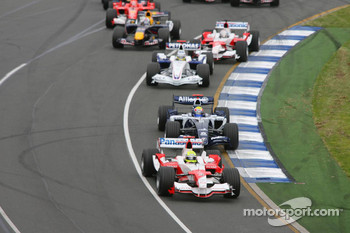 First corner: Ralf Schumacher leads Mark Webber