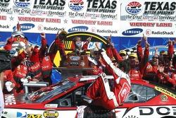 Race winner Kasey Kahne climbs from the car