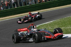 Kimi Raikkonen leads Scott Speed