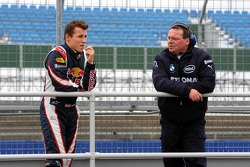 Christian Klien talks with a member of the BMW Sauber F1 Team