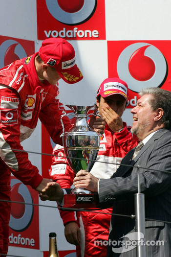 Podium: race winner Michael Schumacher with Kurt Beck
