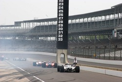 Tire smoke hovers over the pit lane