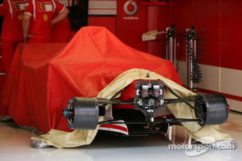 Michael Schumacher's Ferrari is covered for the night
