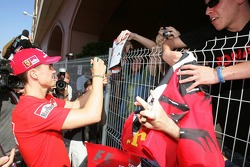 Michael Schumacher signs autographs for fans