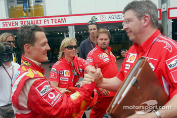 Michael Schumacher celebrates with Ross Brawn