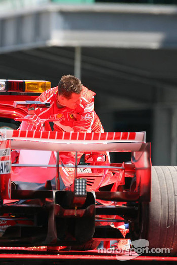 Michael Schumacher stopped in a gravel trap and taken back to the pits on a truck