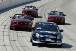 Will Ferrell and the cast of Talladega Nights take a lap around the Chicagoland Speedway in a quartet of Ford cars