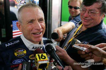 Mark Martin responds to questions from the media in front of his hauler
