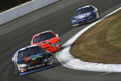 Denny Hamlin leads Jeff Burton and Kurt Busch