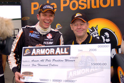 Garth Tander with the pole position cheque