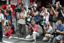 Photographers wait for Michael Schumacher