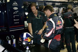 Personal trainer Simon Fitchett and David Coulthard in the garage