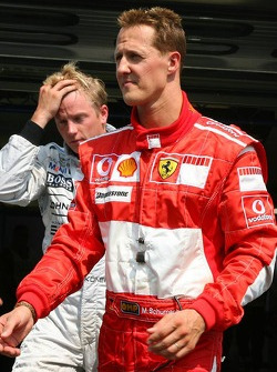 Michael Schumacher and pole winner Kimi Raikkonen