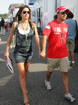 Felipe Massa arrives at the circuit with his girlfriend Rafaela Bassi