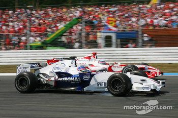 Jacques Villeneuve and Takuma Sato