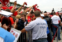 Security hold back fans as Michael Schumacher signs autographs