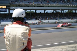 A safety crew member watches practice action