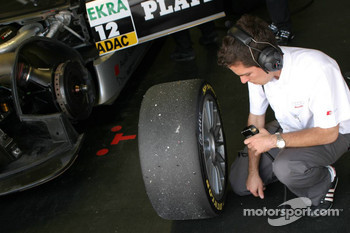 Engineer checks the tyres of Christian Abt