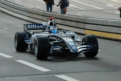 Nico Rosberg driving through Rotterdam's city centre
