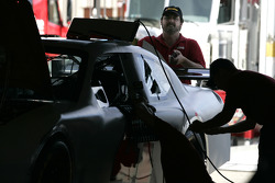 Team members with Chip Ganassi Racing with Felix Sabates work on one of their Dodge Chargers
