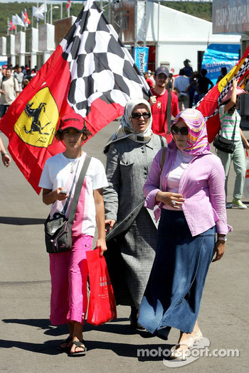 Ferrari fan and women wearing scarfs