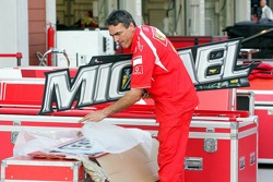 A mechanic puts away the garage sign of Michael Schumacher