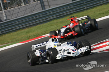 Nick Heidfeld leads Christijan Albers