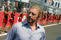 Boris Becker with grid girls