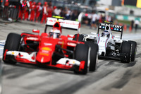 Valtteri Bottas, Williams FW37 behind Kimi Raikkonen, Ferrari SF15-T