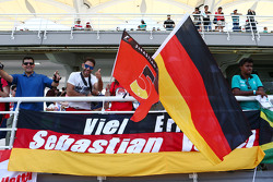 Sebastian Vettel, Ferrari fans and flags