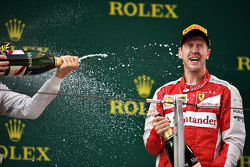 Sebastian Vettel Ferrari celebrates his third position with the champagne on the podium