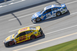 Joey Logano, Team Penske Ford and Clint Bowyer, Michael Waltrip Racing Toyota