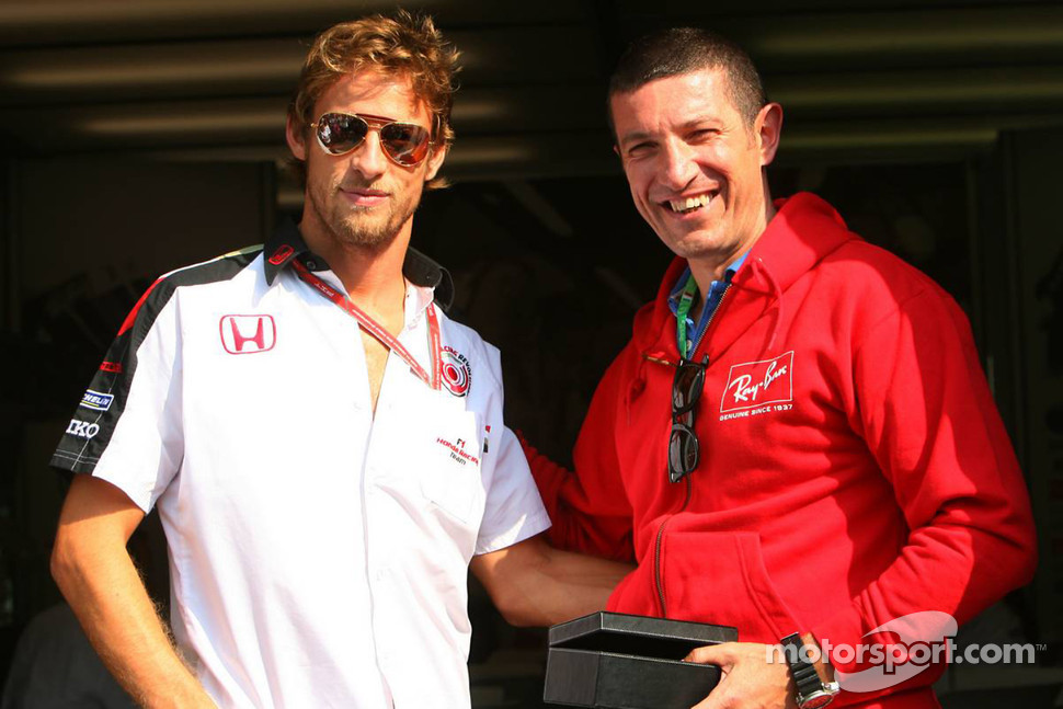 Jenson Button is presented with a 24ct Gold pair of his favourite