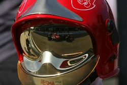 Scott Speed reflection in fire marshals helmet