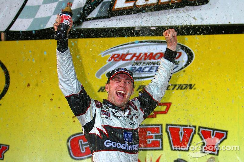 Victory lane: race winner Kevin Harvick celebrates