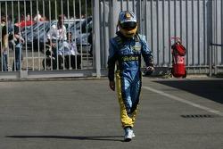 Fernando Alonso walks back to the pits