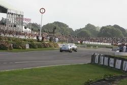 Crowds line the pit straight