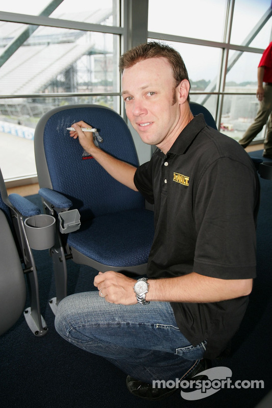 Matt Kenseth signs a seat in the Dupont Monster Bridge