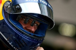 Red Bull Racing refueler has a device infront of his eye inside his helmet
