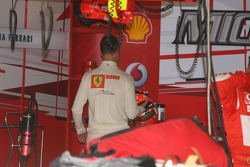 Michael Schumacher puts back his helmet after a bad qualifying session