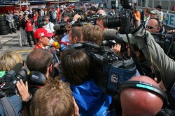 Michael Schumacher speaks with the media after a bad qualifying session