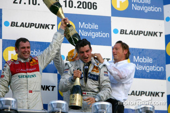 Podium: Bruno Spengler gets a champagne shower from Tom Kristensen, Jamie Green and Hans-Jürgen Mattheis