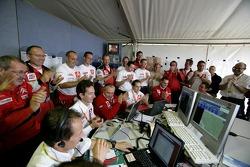 Kronos Total Citroen team members celebrate the 2006 World Rally Champion of Sébastien Loeb