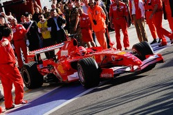 Michael Schumacher exits the garage