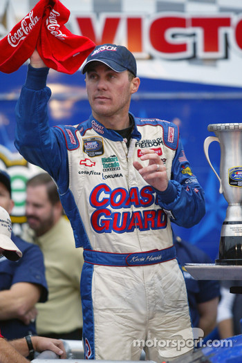 Victory lane: race winner Kevin Harvick celebrates