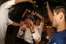 BP-Ford World Rally Team supremo Malcolm Wilson gets the full champagne treatment as Ford win the 2006 World Rally Champion
