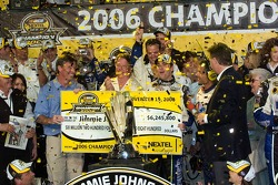 Championship victory lane: 2006 NASCAR Nextel Cup champion Jimmie Johnson is presented with the 6.2 million check