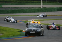Formula BMW cars behind the safety car