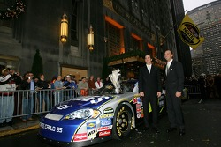 Jimmie Johnson and Chad Knaus pose for a photo outside the Waldorf=Astoria hotel prior to the NASCAR NEXTEL Cup Series awards ceremony